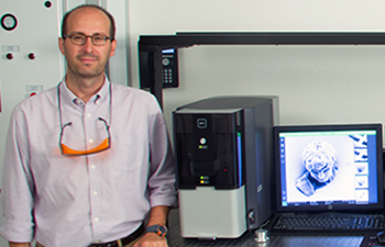 Dr. Tommaso Baldacchini standing next to his Phenom Scanning Electron Microscope