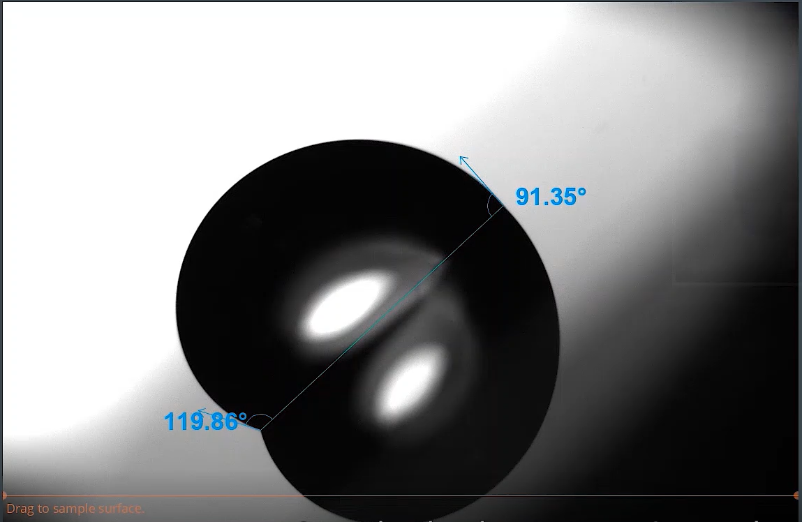 Image of drop with measurements with tilting angle stage